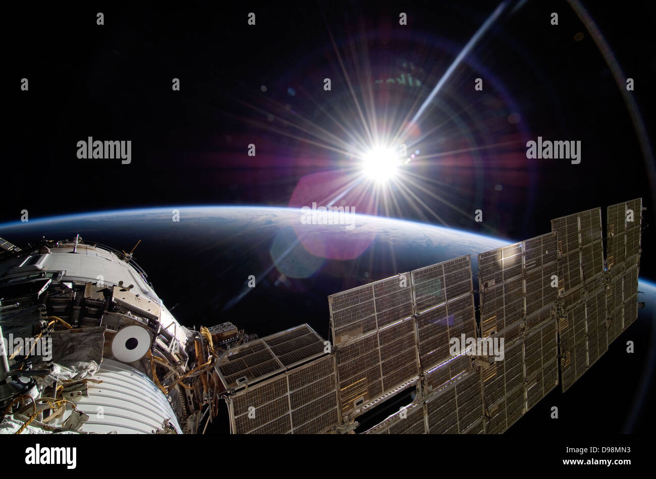 22 November 2009.  The bright sun greets the International Space Station. - Stock Image