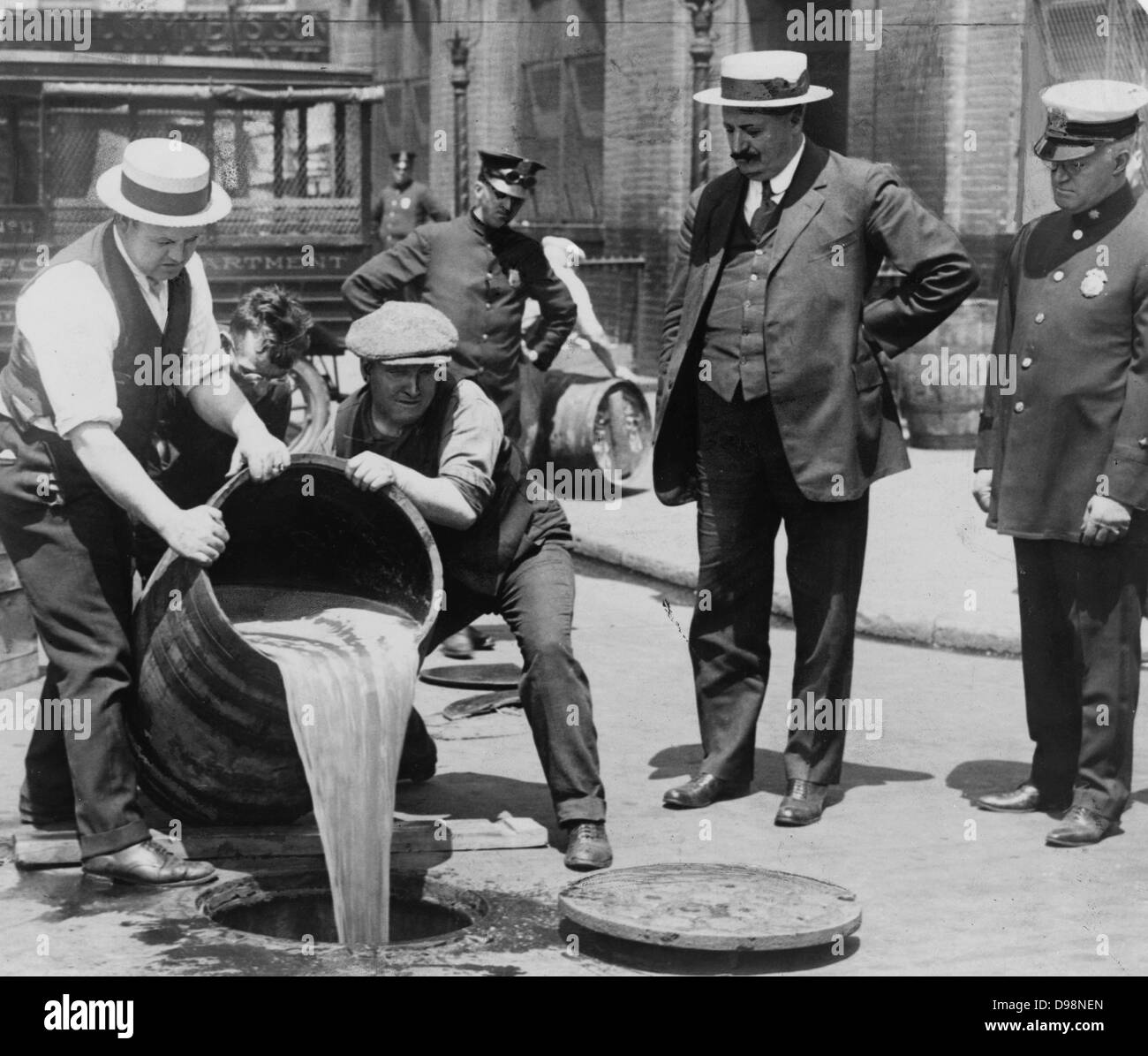 Prohibition in the USA 1920-1933: A barrel of confiscated illegal beer being poured down a drain. Alcohol Temperance - Stock Image