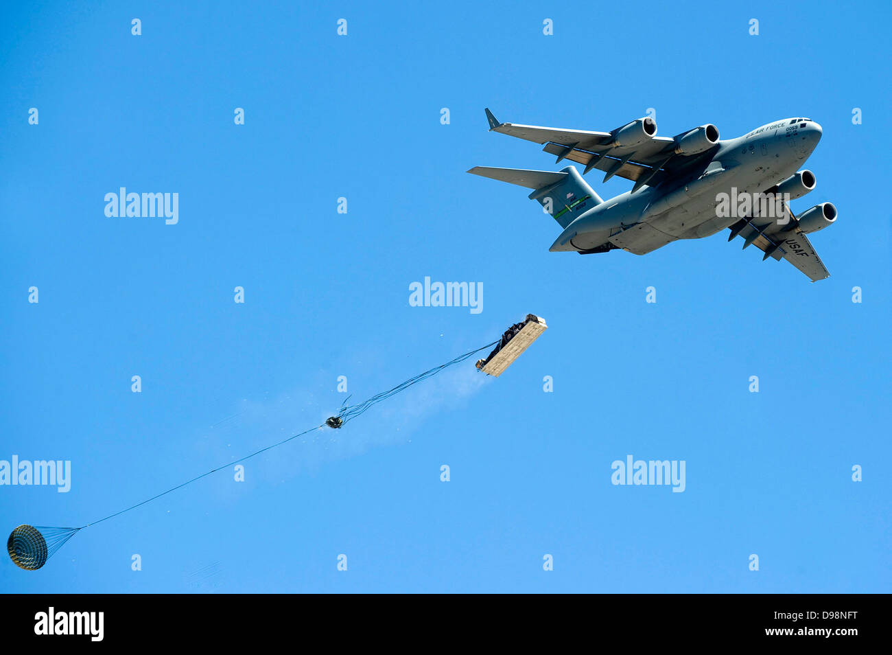 A C-17 Globemaster III from the 62nd Airlift Wing drops military cargo May 31, 2013, during the Joint Forcible Entry - Stock Image