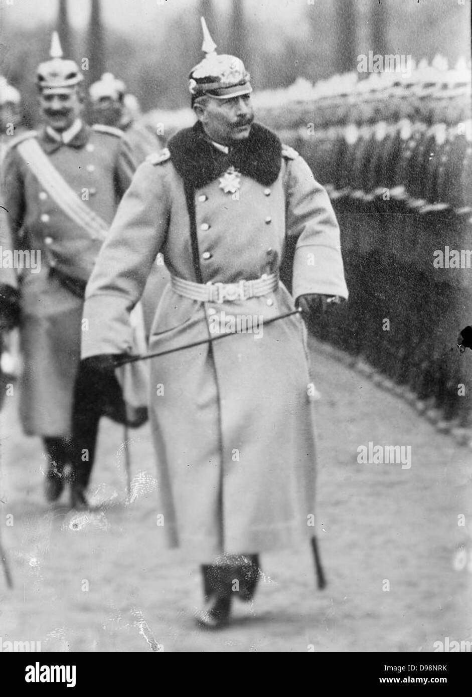 Wilhelm II (1859-1941) Emperor of Germany 1888-1918, in uniform and wearing a pickelhelm, reviewing troops. Military Stock Photo
