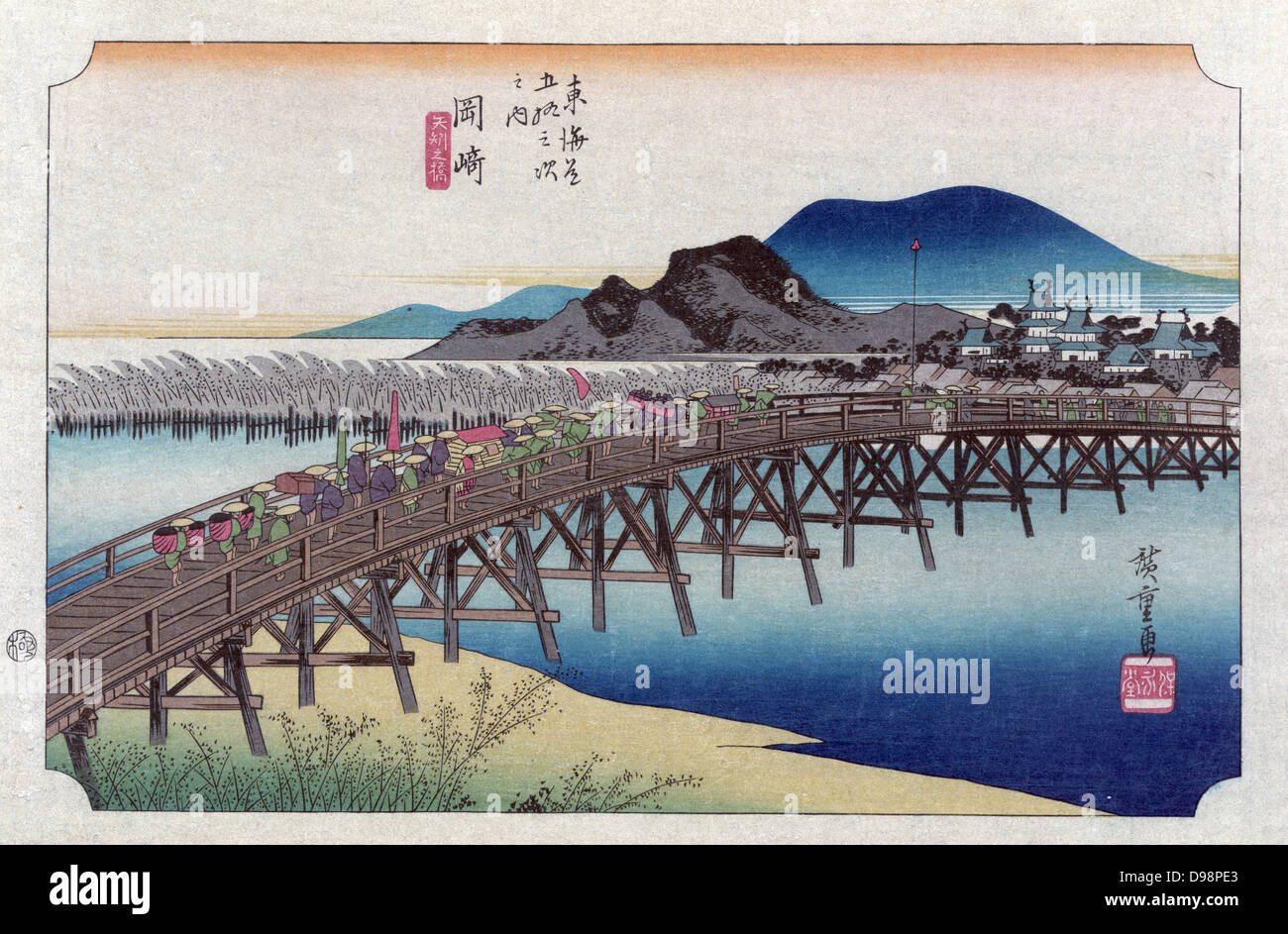 Bridge at the Okasaki station with porters and attendants carrying sedan chair and bundles. From 'The Fifty - Stock Image