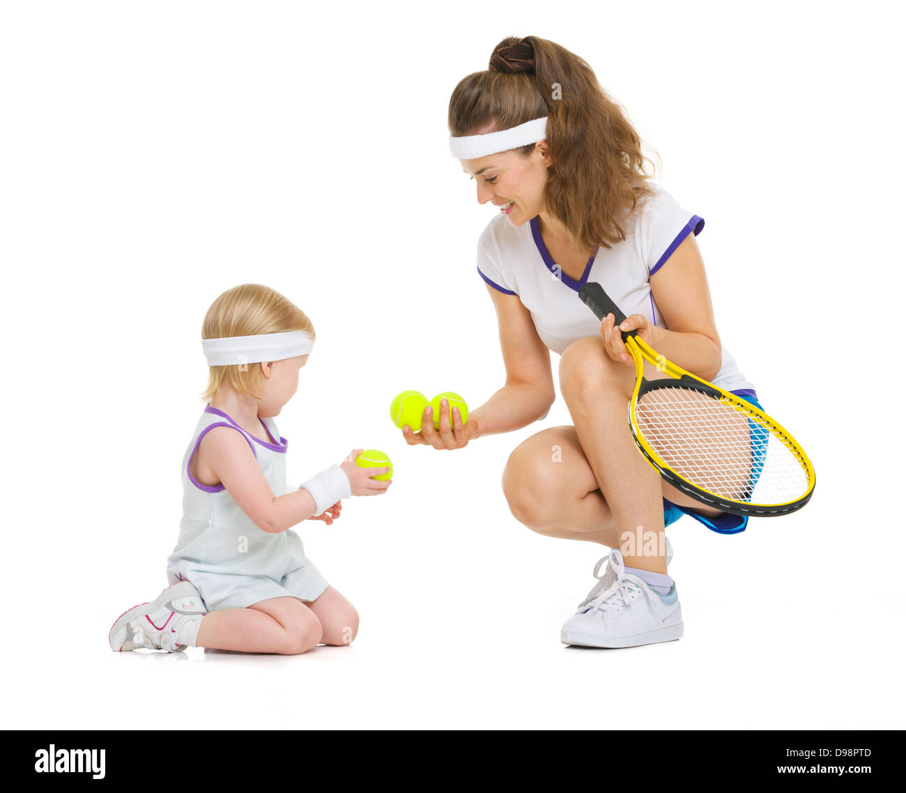 Mother and baby in tennis clothes playing - Stock Image