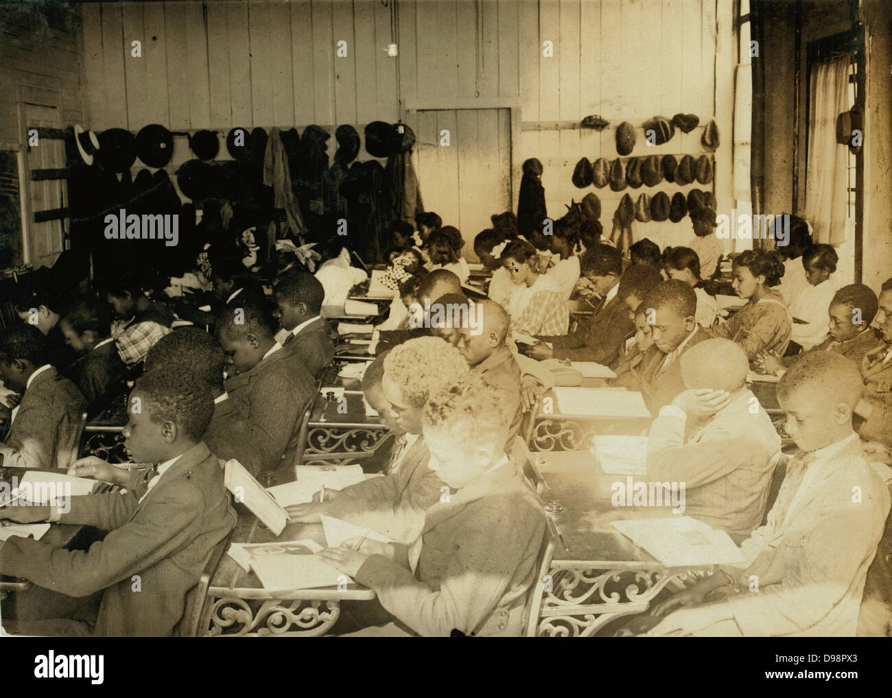 African-American Sixth Grade school children crammed into a small room in an old storehouse and taught by a single - Stock Image