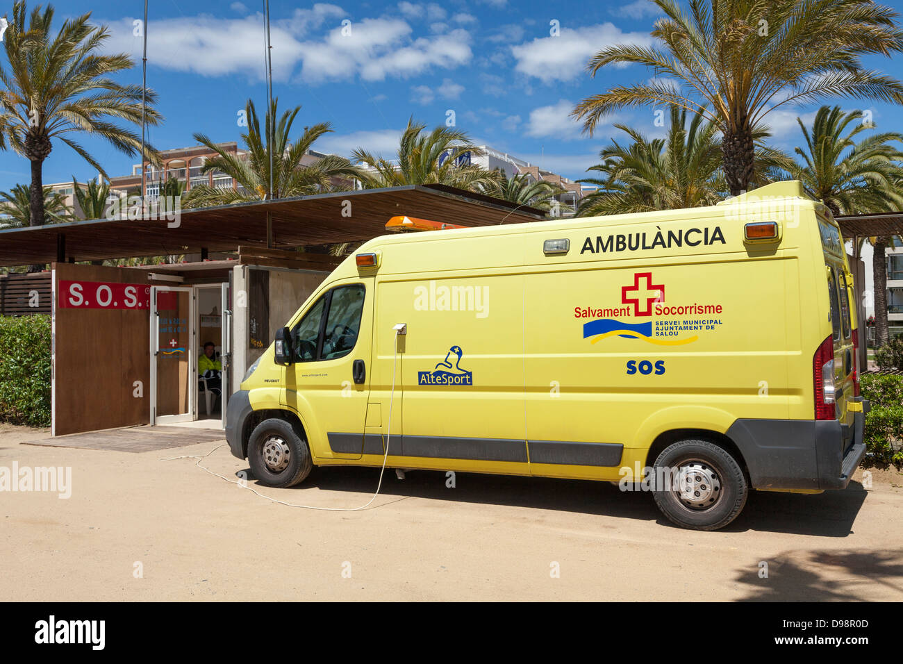 Ambulancia plugged into mains by promenade SOS station in Spain - Stock Image