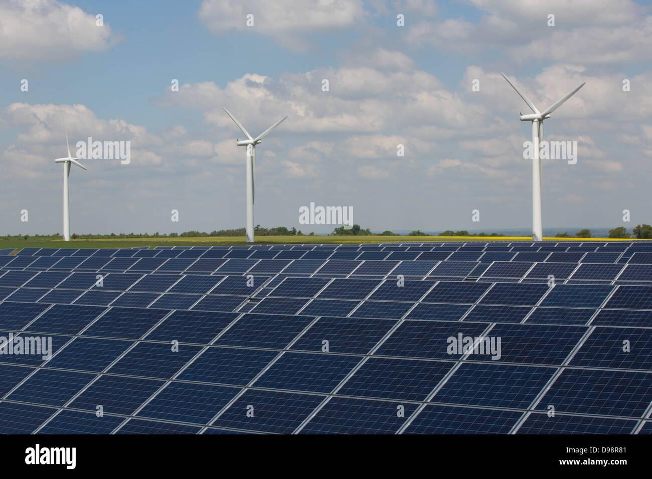 Solar panels and wind turbines on an energy farm - Stock Image