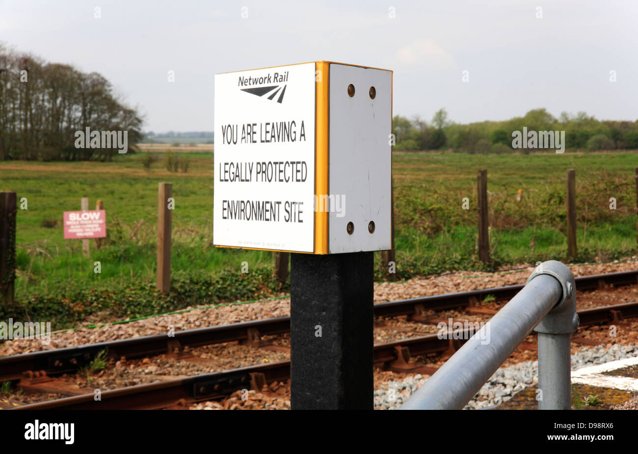 A notice advising of leaving a legally protected environment site at Buckenham Station, Norfolk, england, United - Stock Image
