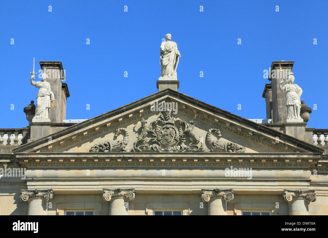 Houghton Hall, Norfolk, detail of coat of arms and statuary, England UK - Stock Image
