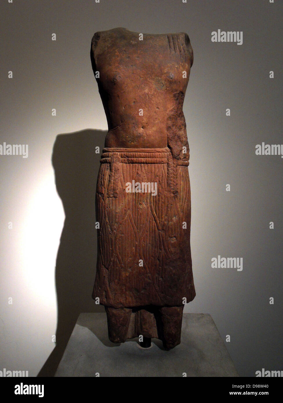 Torso of Brahmanic ascetic early 2nd century. Kushan dynasty (1st-3rd AD) Buddhist red sandstone sculpture from - Stock Image