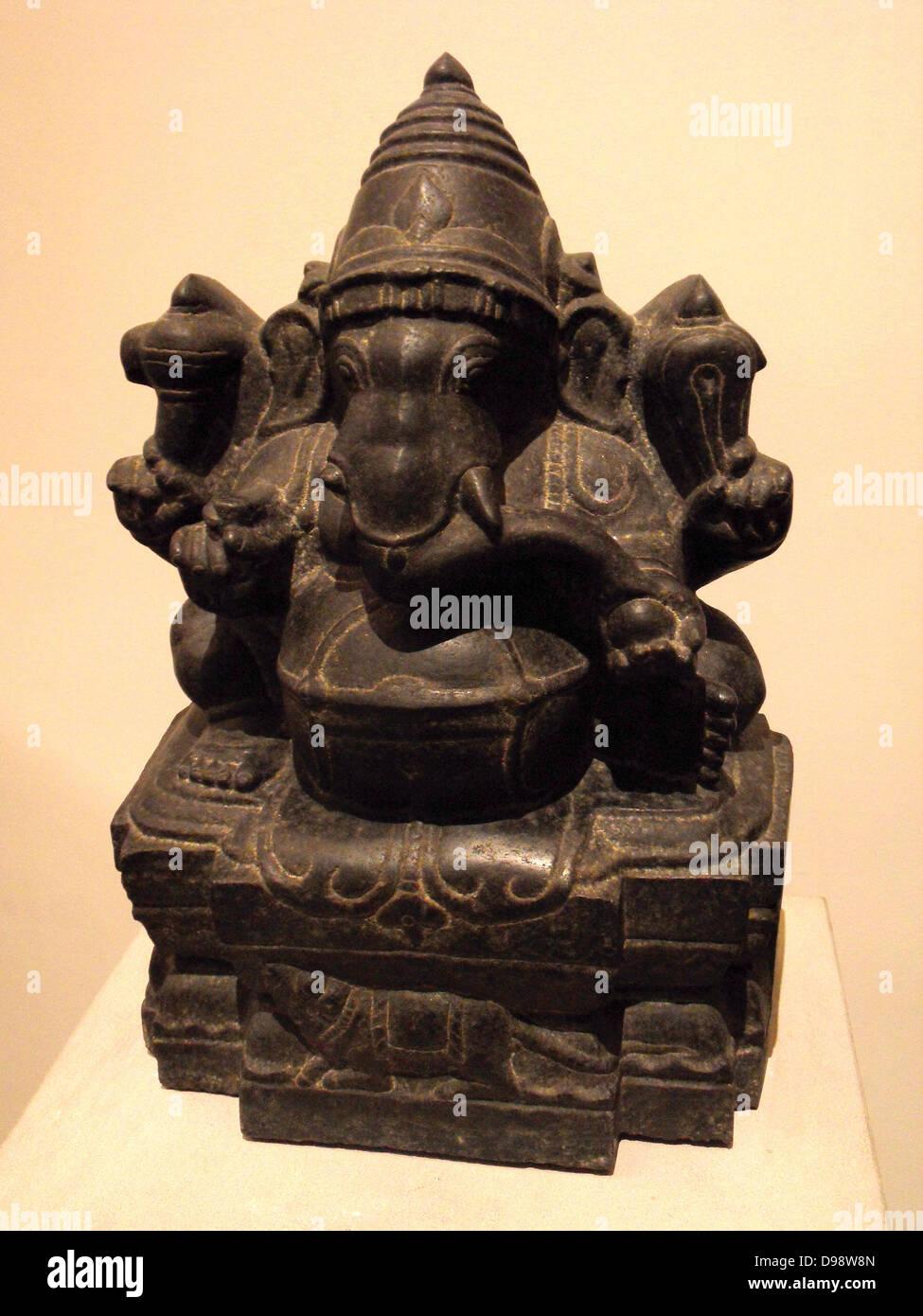 black polished granite sculpture of the Hindu god Ganesha; Dravidian - Stock Image