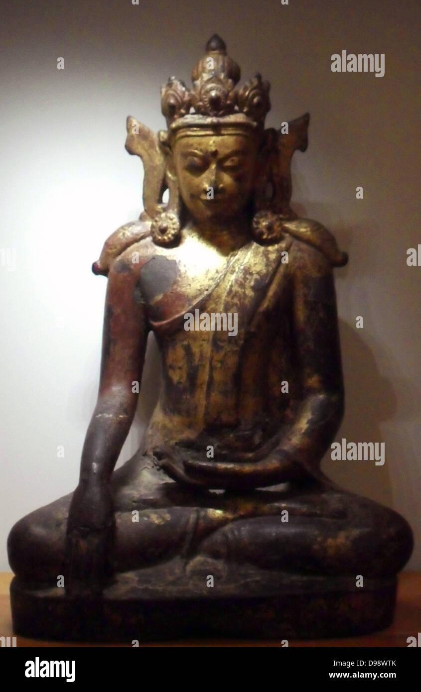Buddha Maravijaya Pare. Burmese (Myanmar) XV-XVI century Bronze Gilded and painted - Stock Image