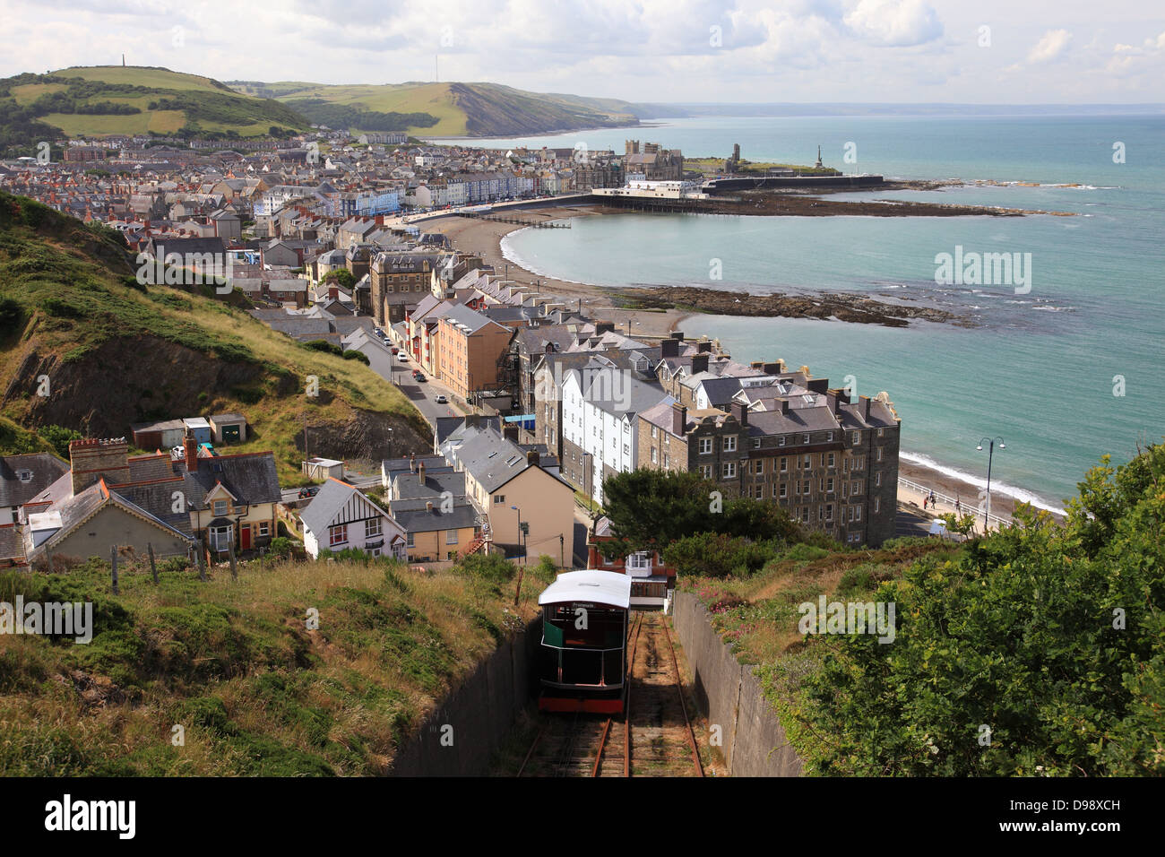 View of Aberystwyth beach, bay and promenade from Constitution Hill, its funicular railway in the foreground - Stock Image
