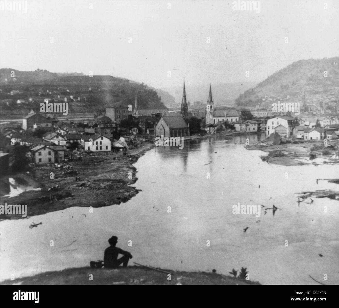 Johnstown disaster, May 31, 1889. Conemaugh Valley. photographic print on stereo card : stereograph. Man seated - Stock Image