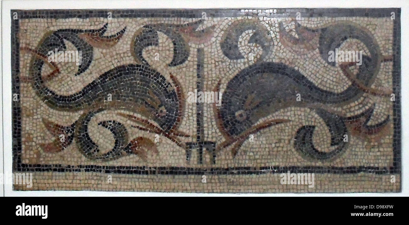 Dolphins with leaf-like fins on either side of a trident. Roman Mosaic from England circa 1st to 4th century AD - Stock Image