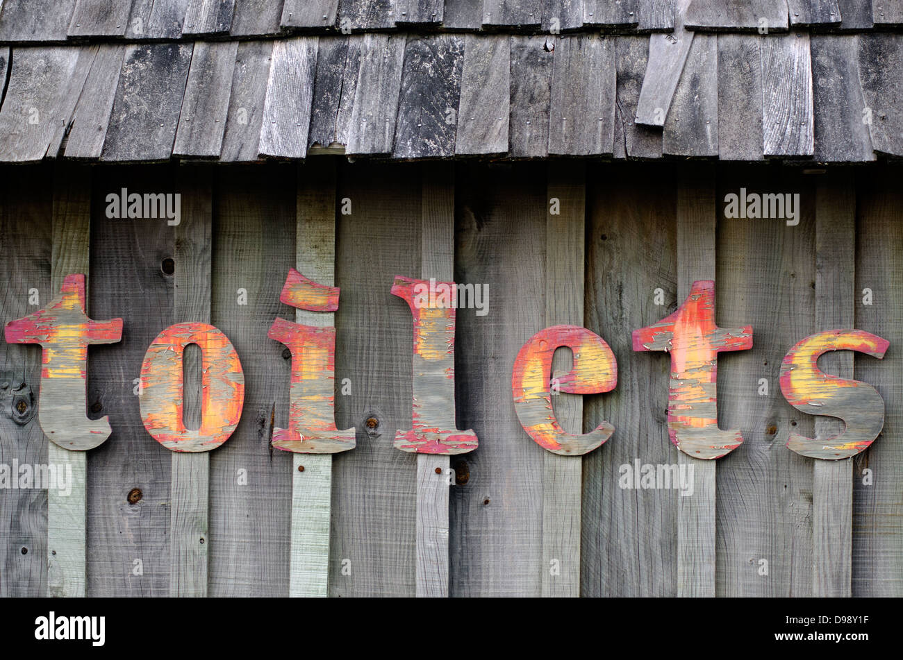 The wording of Toilets on a wooden wall. - Stock Image