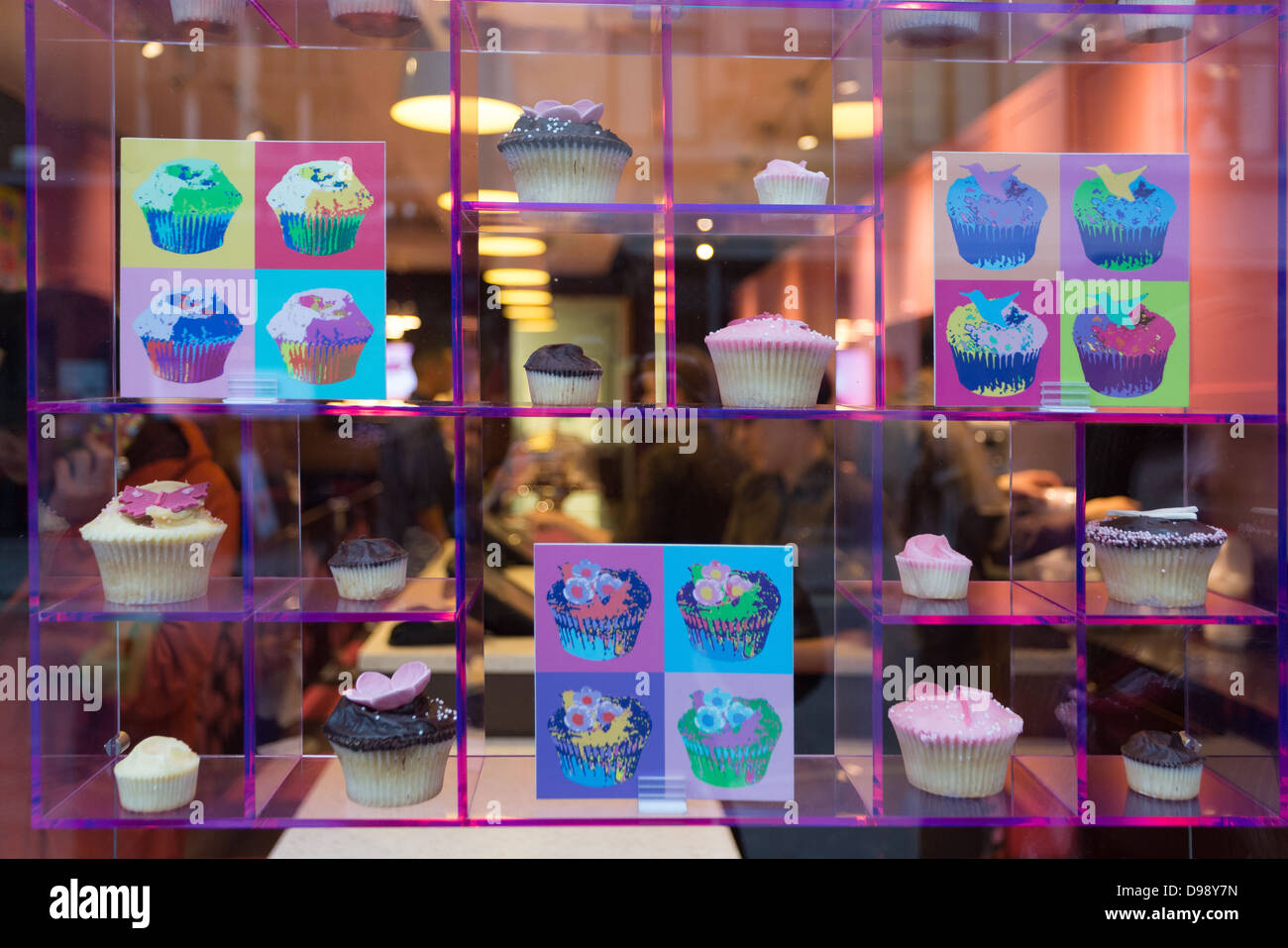 Shop window display showing traditional cupcakes, Wardour street, London, United Kingdom - Stock Image