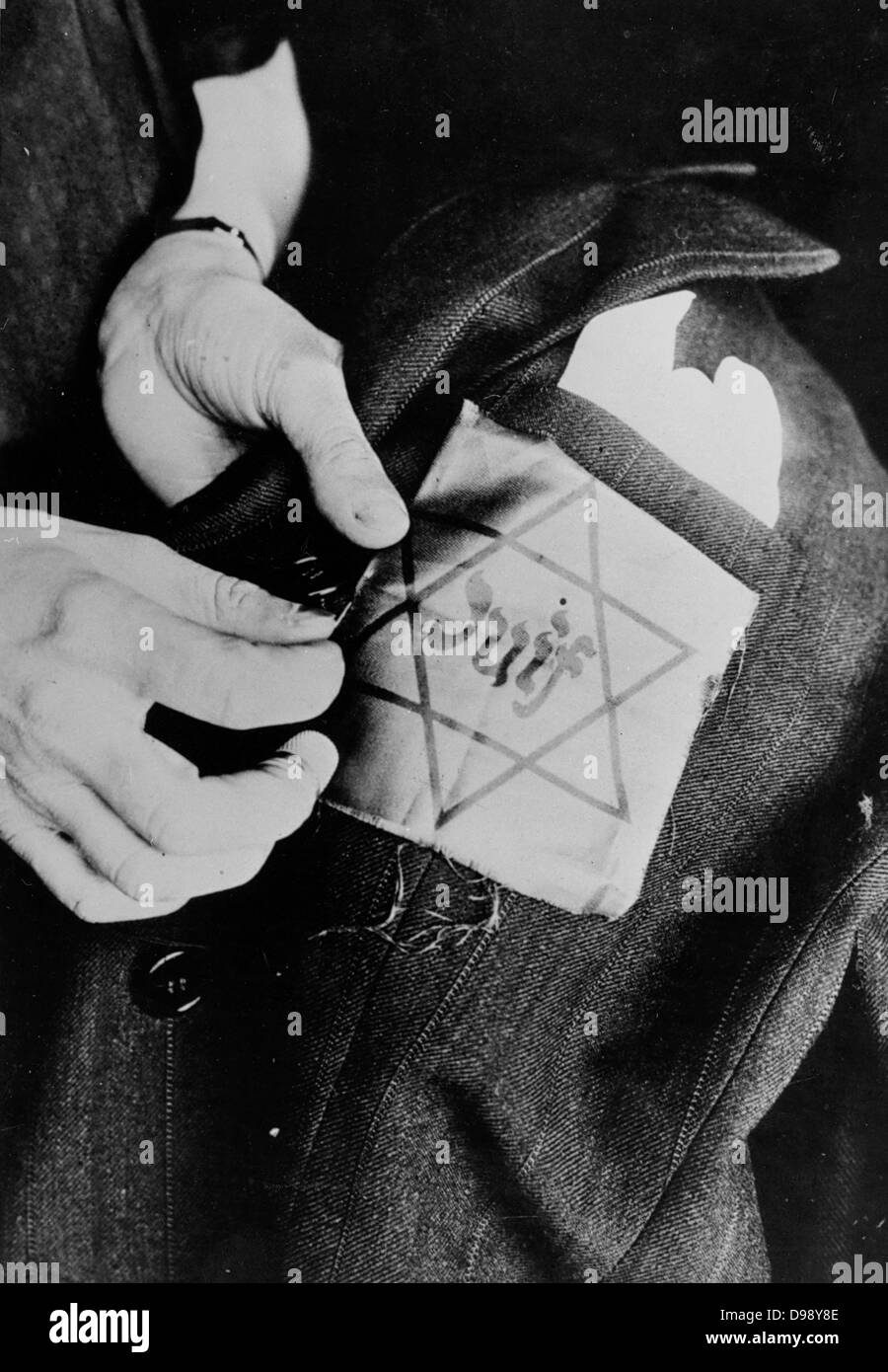 Yellow star badge worn by Jews in Nazi occupied Europe circa 1941 - Stock Image