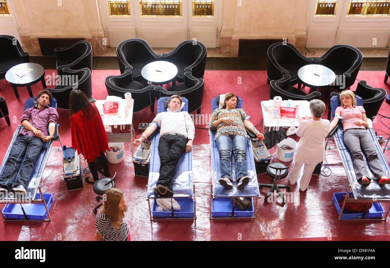 People donate blood as part of a German Red Cross blood donation campaign in the foyer of the Theater des Westens - Stock Image