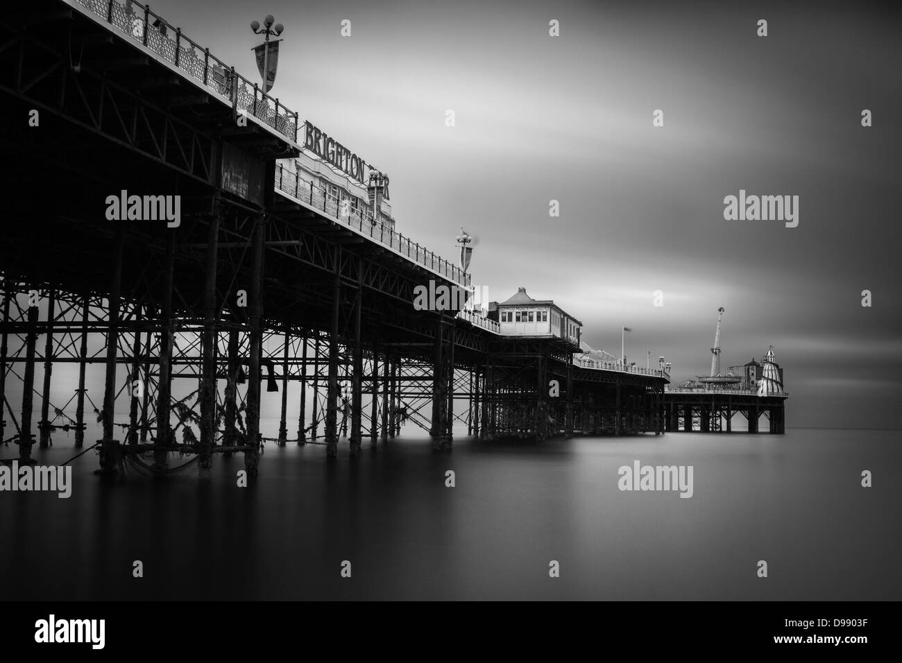 A black and white ND filter shot of Brighton pier, sea front view - Stock Image