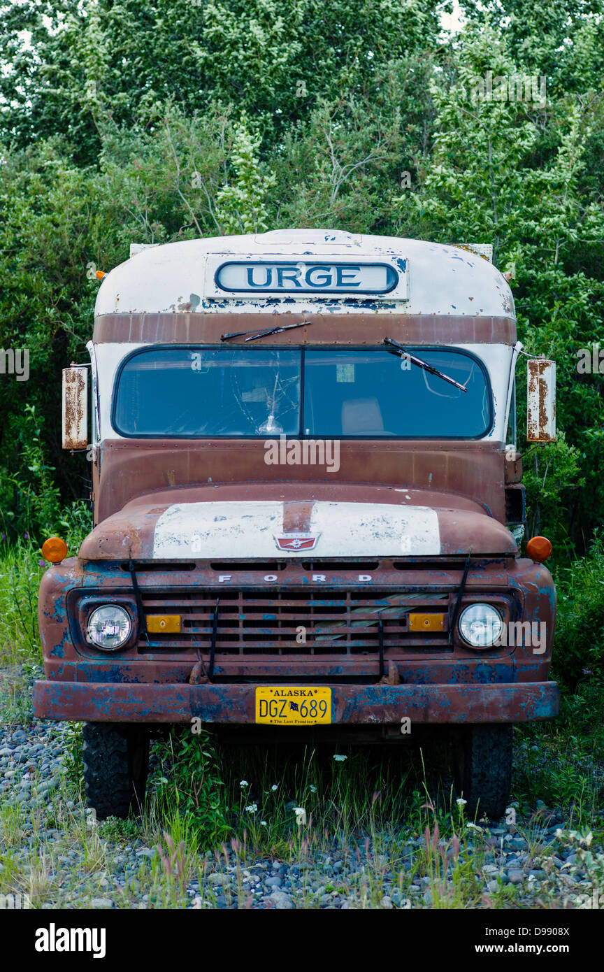 Old school bus converted into a camper, tiny and remote town of Chitina, Alaska, USA - Stock Image