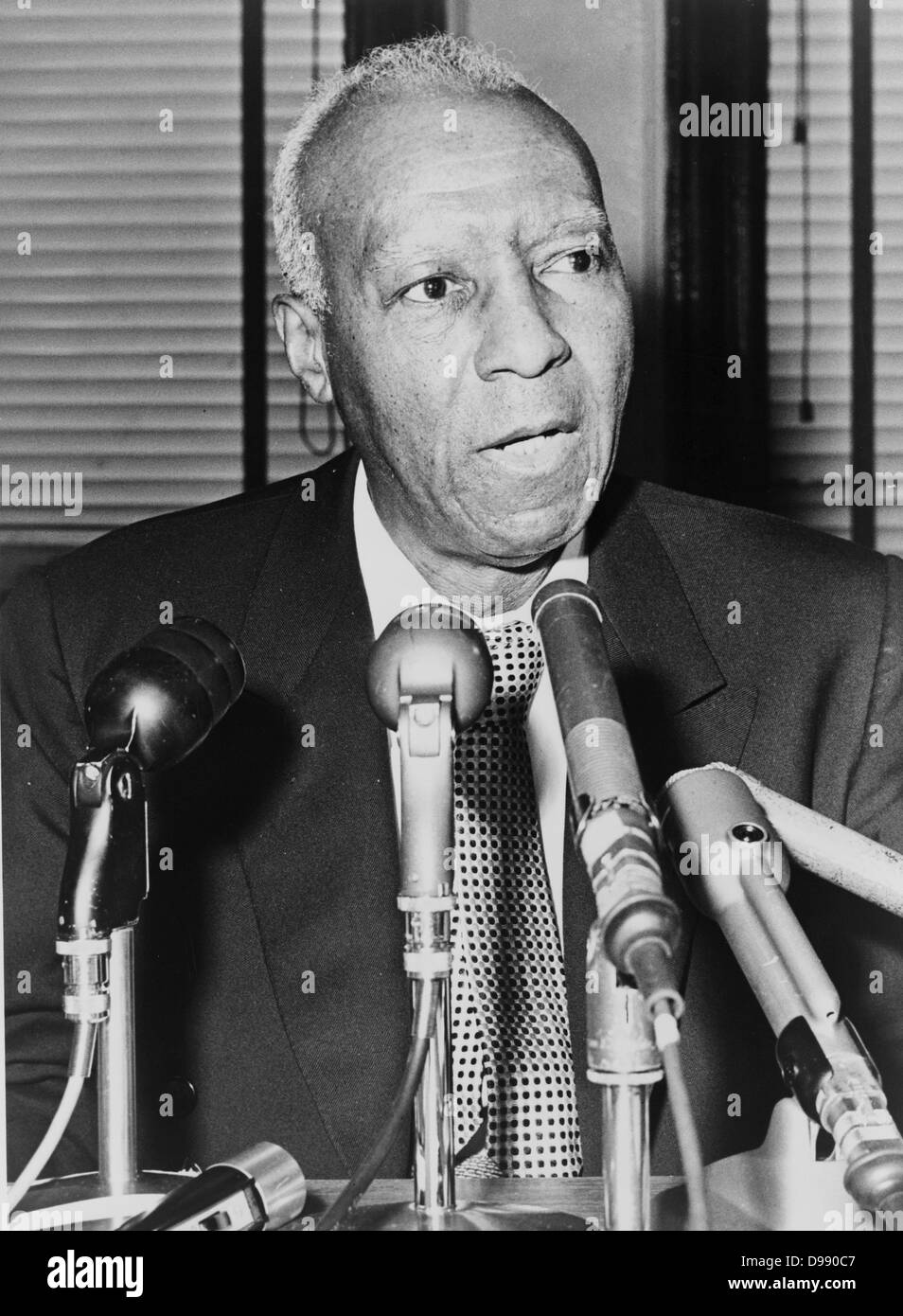 Asa Philip Randolph, half-length portrait, facing slightly right, behind microphones during a press interview / - Stock Image
