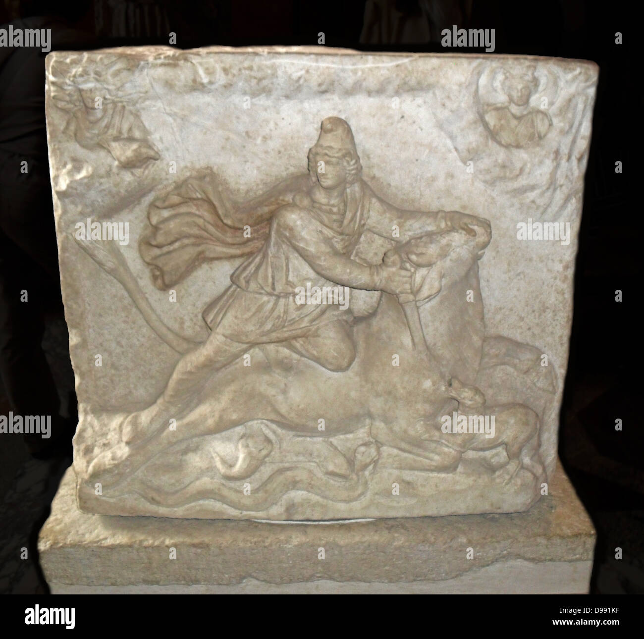 Relief with two sides depicting the Iranian (Persian) god Mithras. Mithras was worshiped in ancient Rome from the - Stock Image