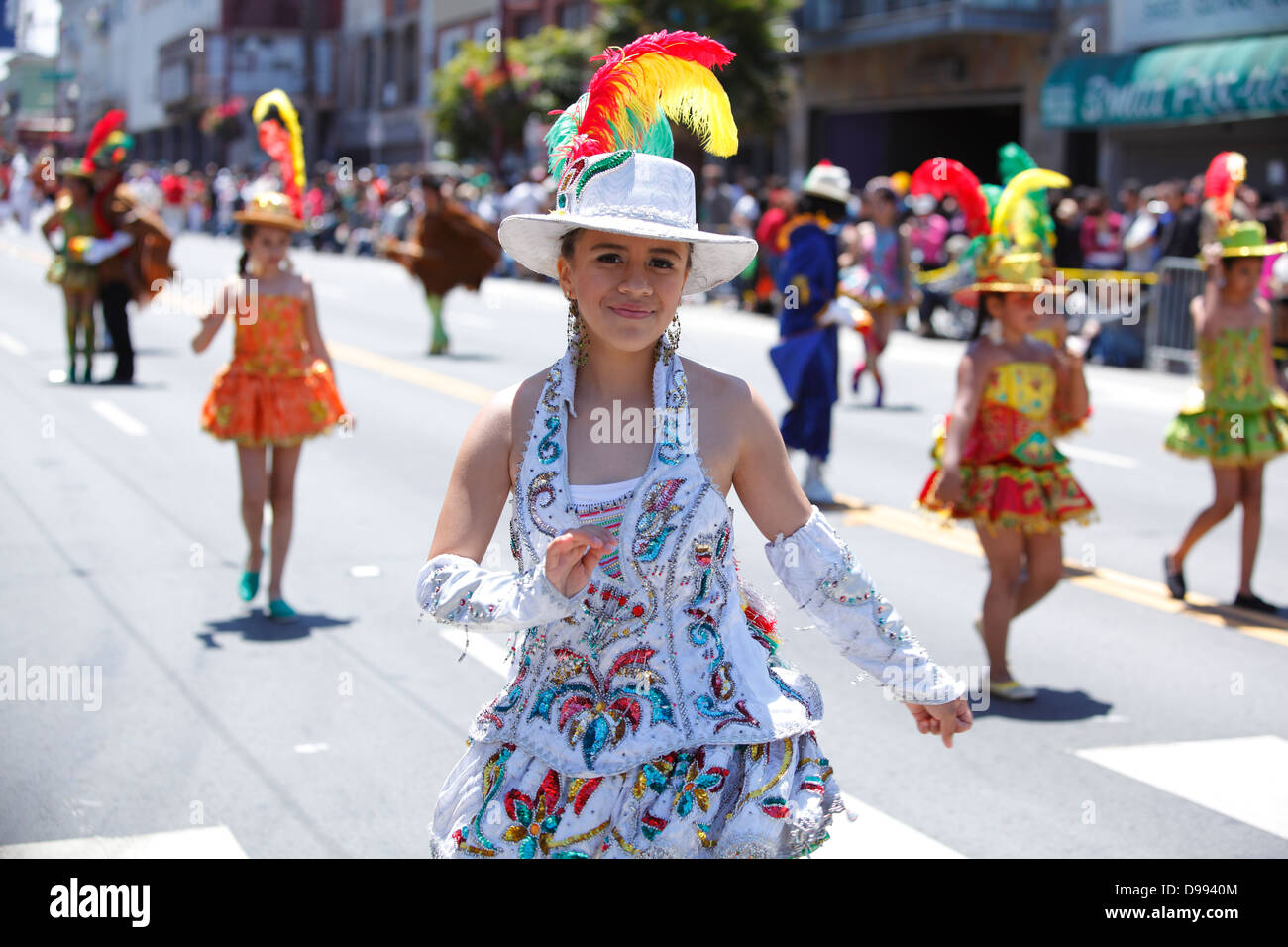 Young girl in traditional bolivian costume during Carnaval parade in Mission District, San Francisco, California, - Stock Image
