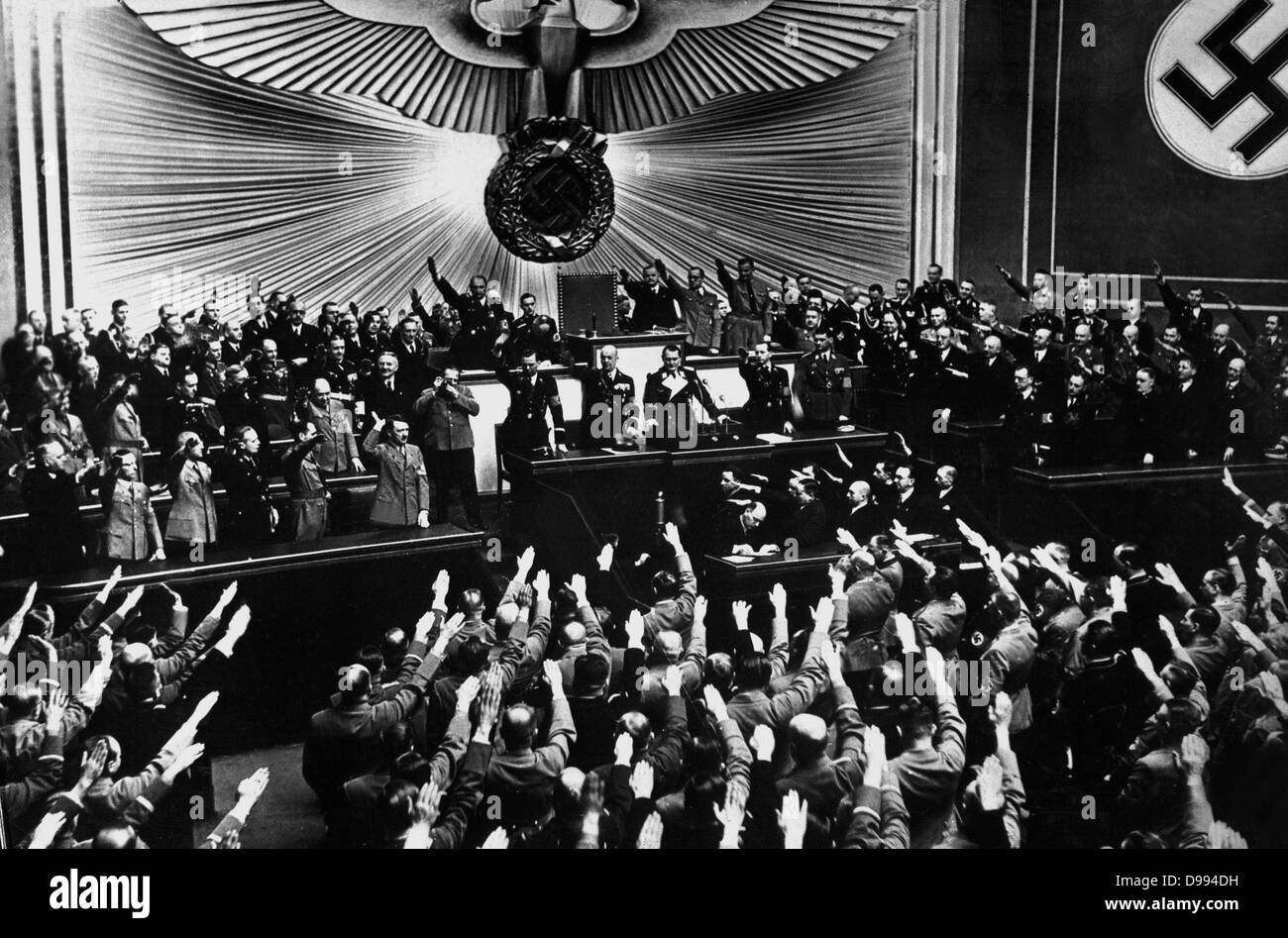 Adolf Hitler receiving an ovation in the Reichstag after announcing the peaceful acquisition of Austria Berlin, - Stock Image