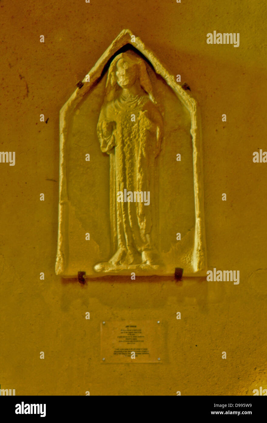 France, Normandy.  Lessay.  Abbatiale - interior showing badly eroded statue. - Stock Image