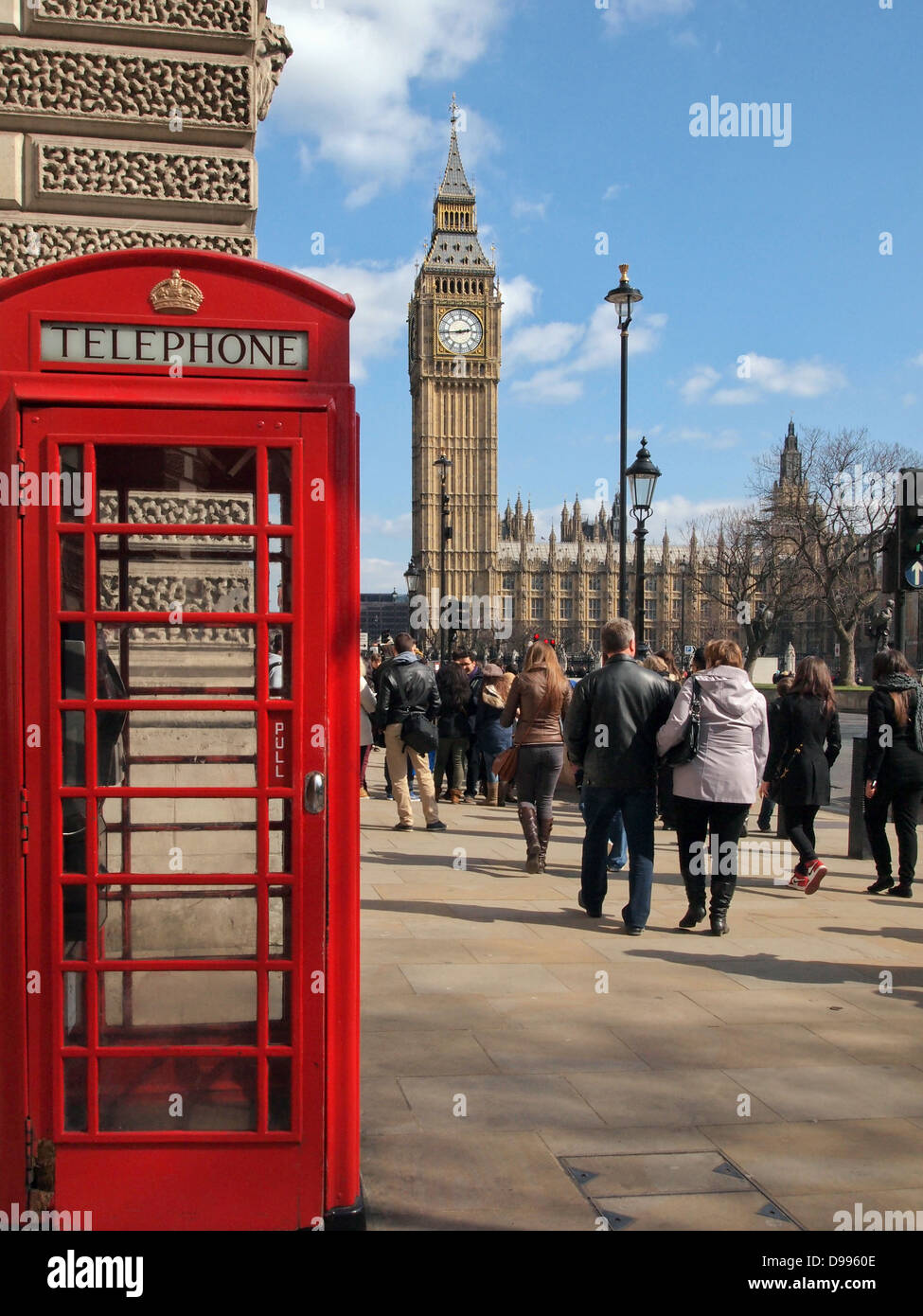 Street scene with red Telephone Box and Big Ben and Parliament Buildings in Background - Stock Image