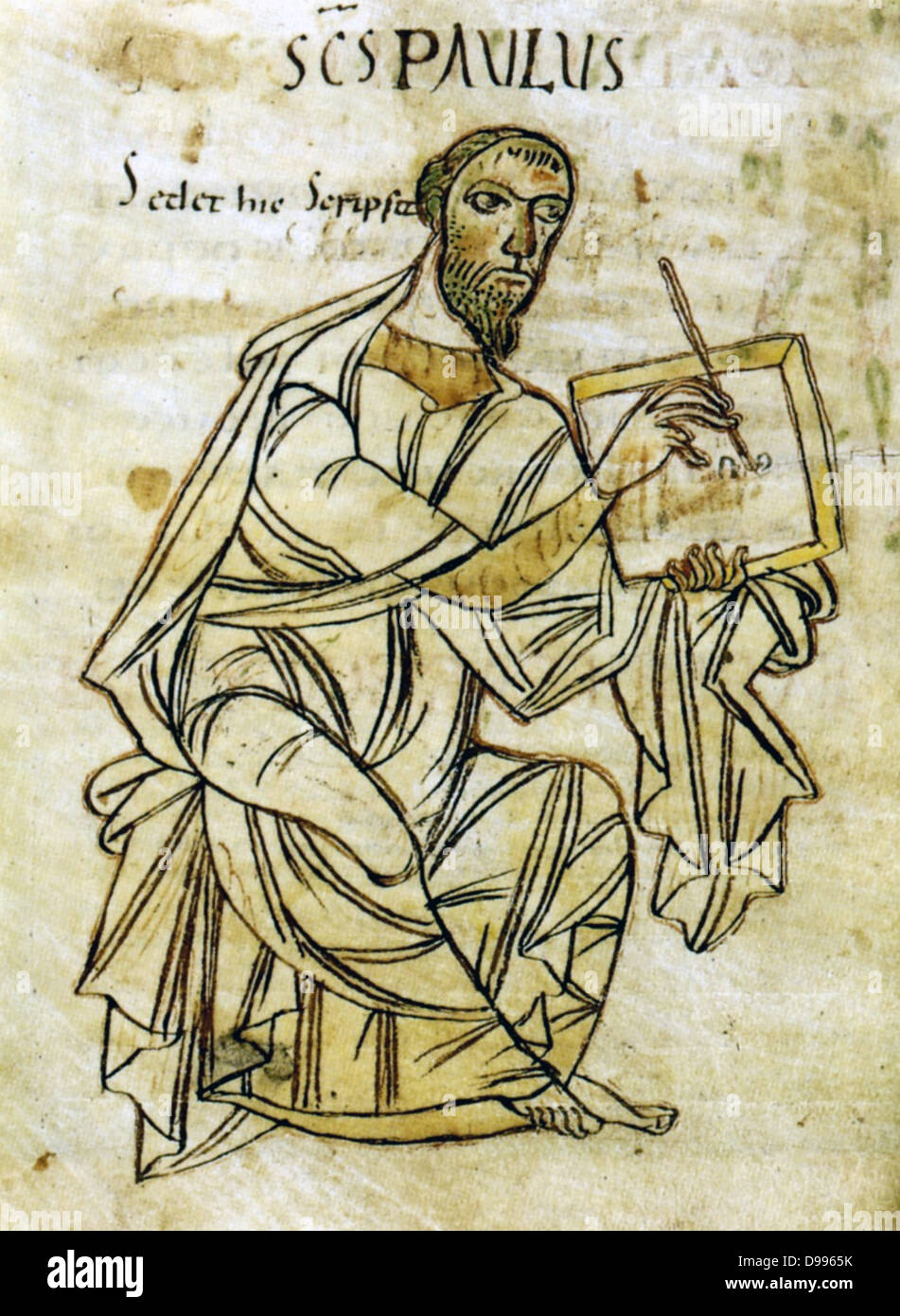 Saint Paul writing. From an early 9th century manuscript version of Saint Paul's letters. The manuscript is - Stock Image