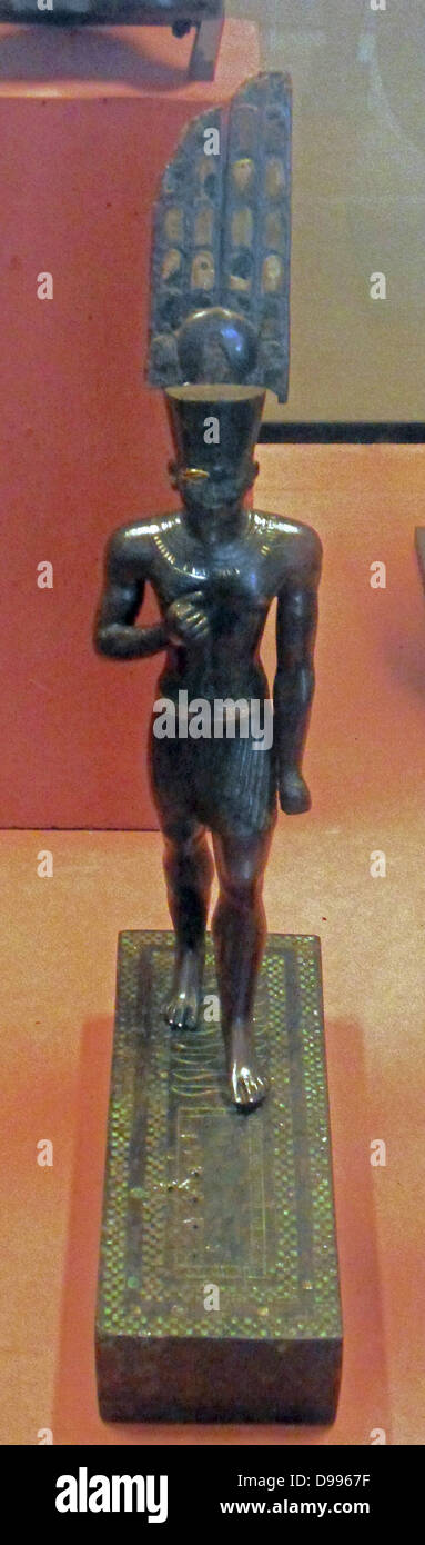 The god Amun 25-26 Dynastic? 715-525 BC. Black and bronze inlaid plate - Stock Image