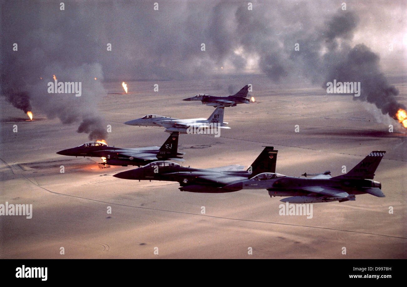 Operation Desert Storm (1991) F-16A Fighting Falcon, F-15E Strike Eagle, and F-15C Eagle fighter jets fly over Kuwait's - Stock Image