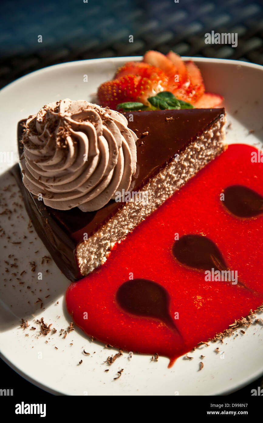 chocolate mouse cake with strawberry sauce - Stock Image