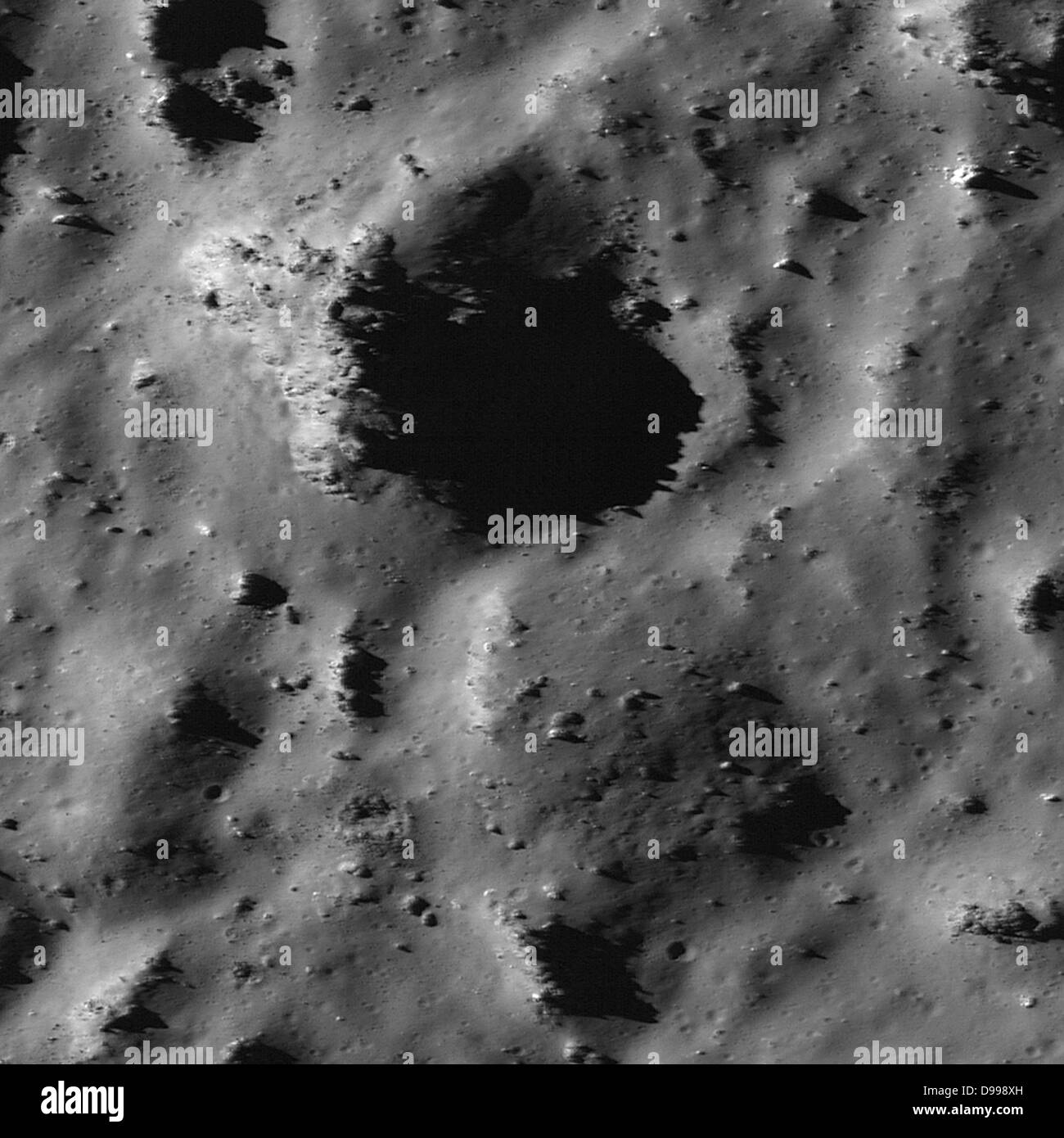 Depressions and positive relief features in Tycho crater were caused by a complex mixture of granular material and - Stock Image