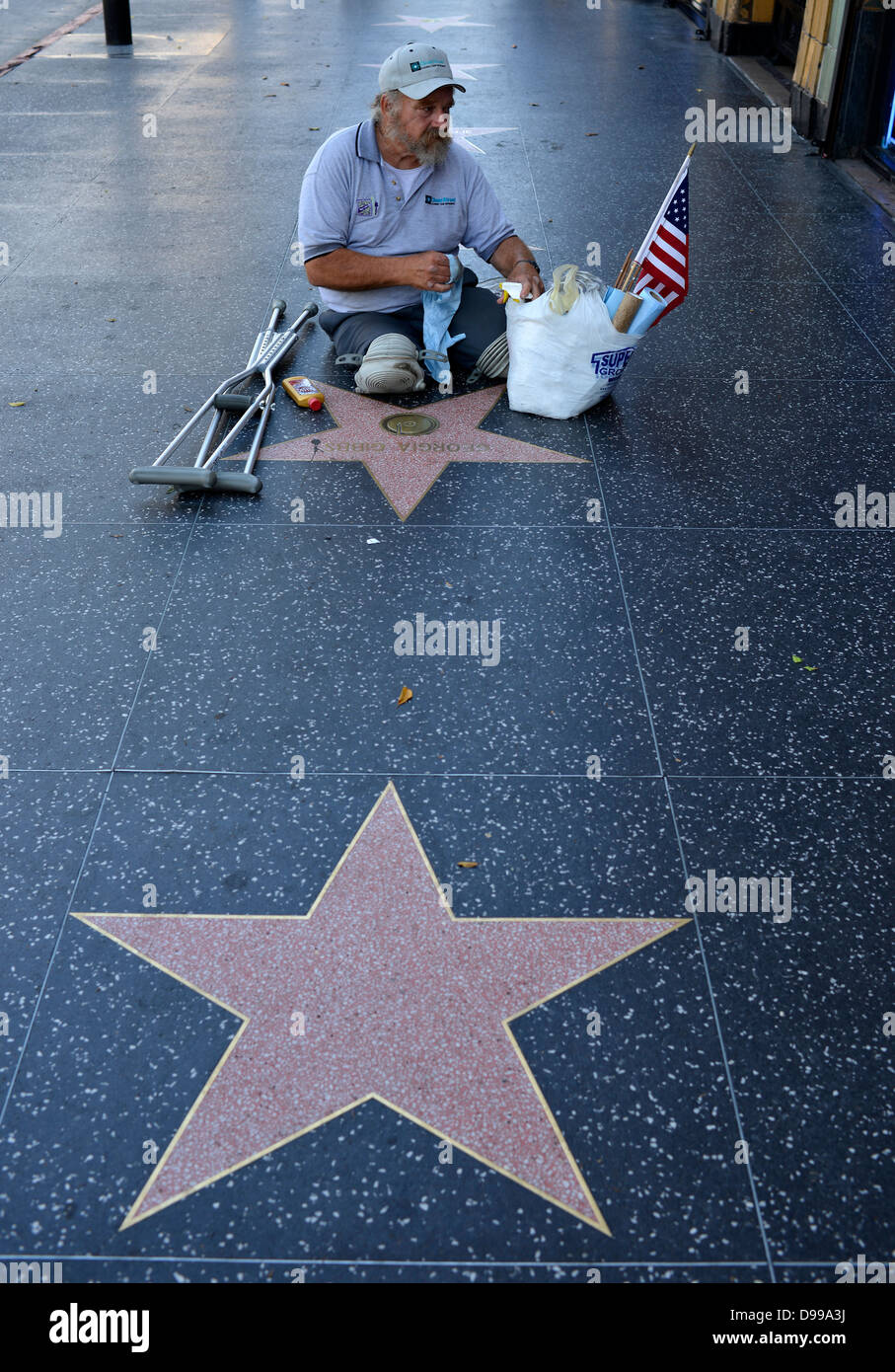 War ex-serviceman cleans Terrazzo stars for artists, Drumming of Fame, Hollywood boulevard, Hollywood, Los Angeles, - Stock Image