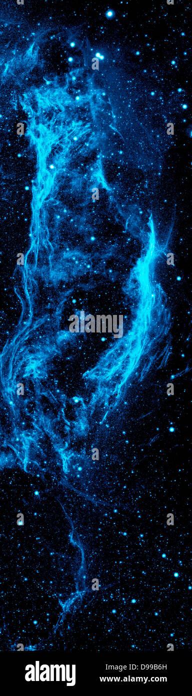 The Cygnus Loop nebula, taken by NASA's Galaxy Evolution Explorer. The nebula lies about 1,500 light-years away, - Stock Image