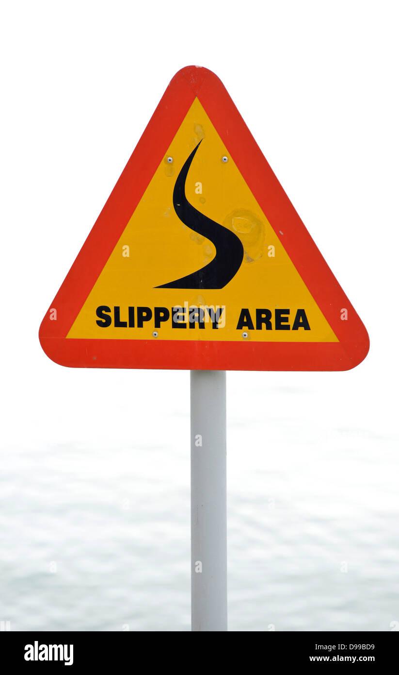 Sign slide danger, Slippery area - Stock Image