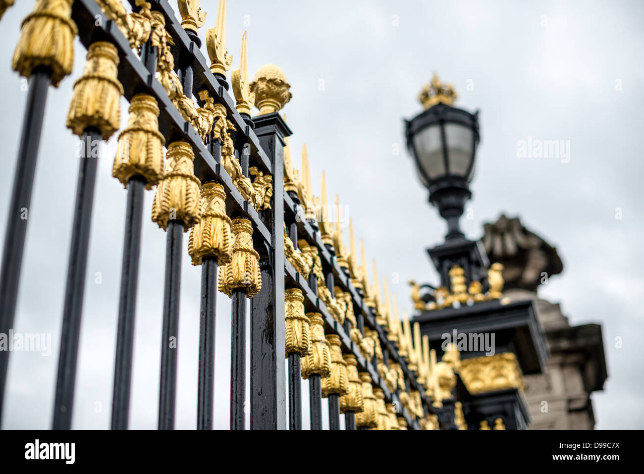 BRUSSELS, Belgium - Gold decorated gates in front of the Royal Palace of Brussels, the official palace of the Belgian - Stock Image