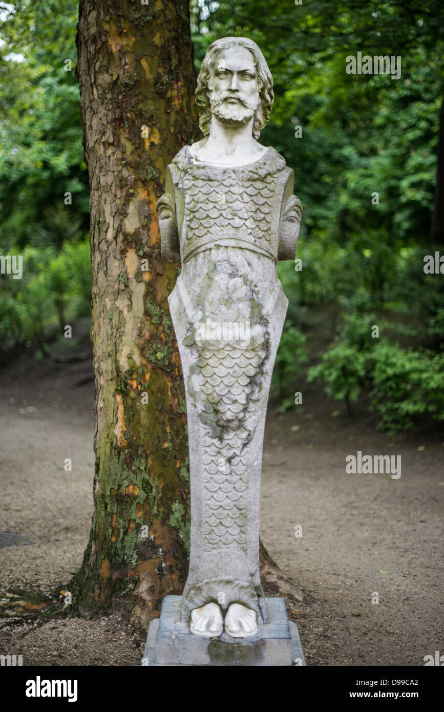 BRUSSELS, Belgium - A statue, partly a male mermaid, in Brussels Park across from the Royal Palace of Brussels in Stock Photo