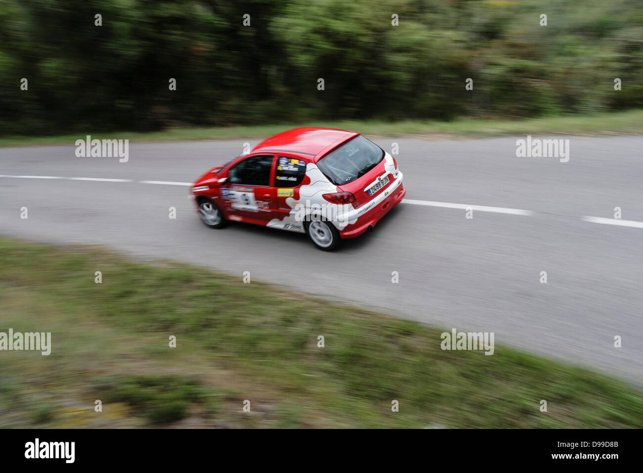 May 25, 2.013 U2013 Girona, Spain   The Peugeot 206 Number 9 Rally Car, Racing  On La Ganga Stage During The 28th Empordà Rally. In This Race Have  Participated ...