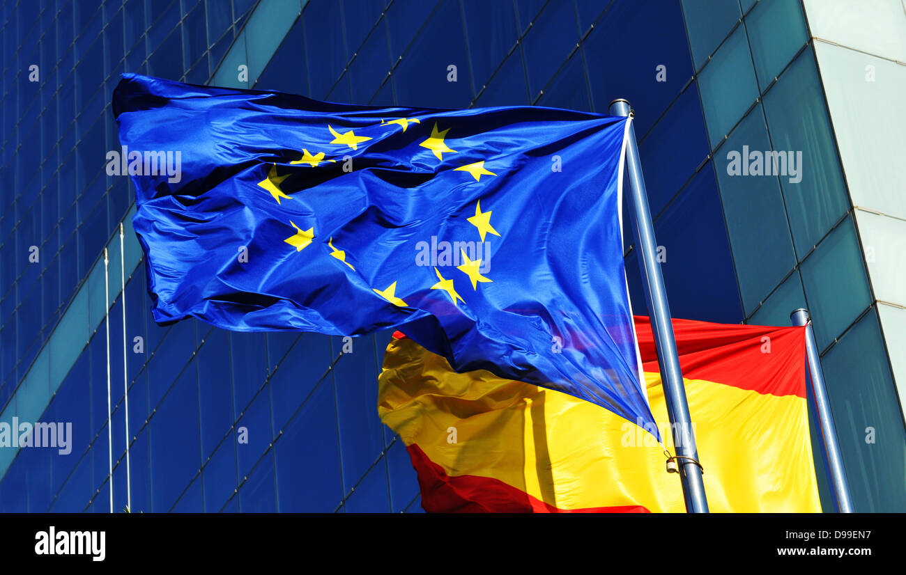 Spain and European Union flags against corporate building - Stock Image