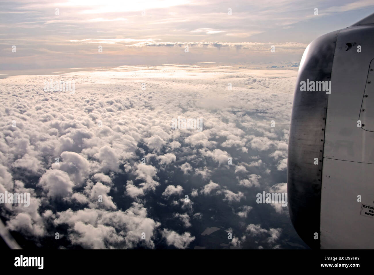 aerial photography of clouds and aircraft engine in the evening - Stock Image