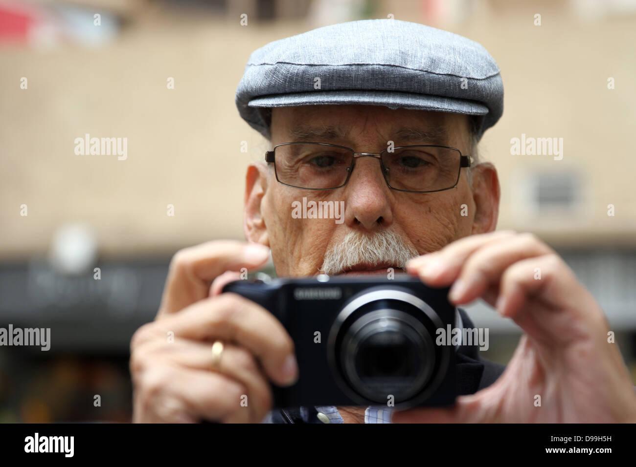Gentleman holding digital camera - Stock Image