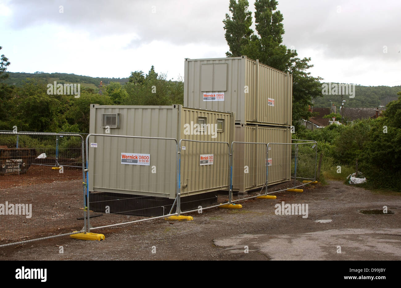 Secure containers used as construction site cabins on a small housing development in Cheddar, Somerset, June 2013. - Stock Image