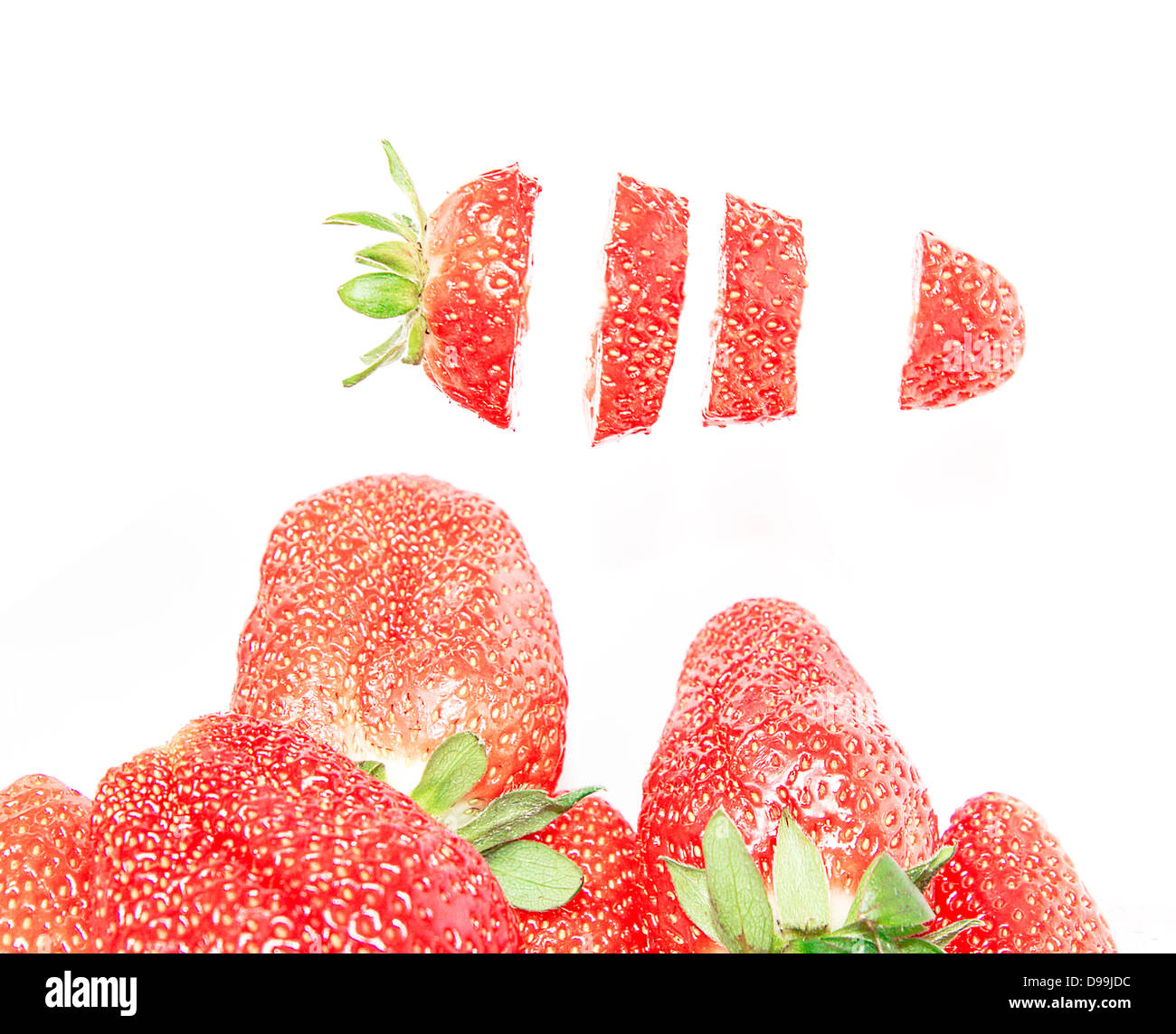 Cut strawberries isolated on white background Stock Photo