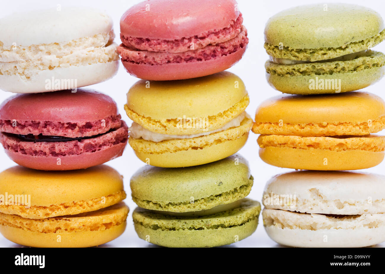 Colourful stacked macaroons. - Stock Image