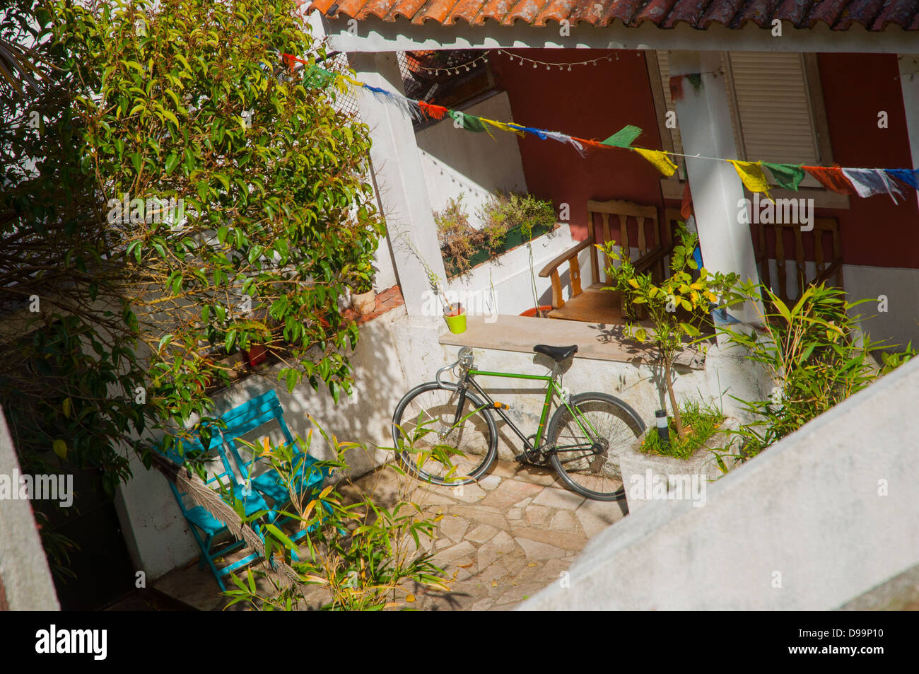 Patio with bicycle and flags Stock Photo: 57377852 - Alamy