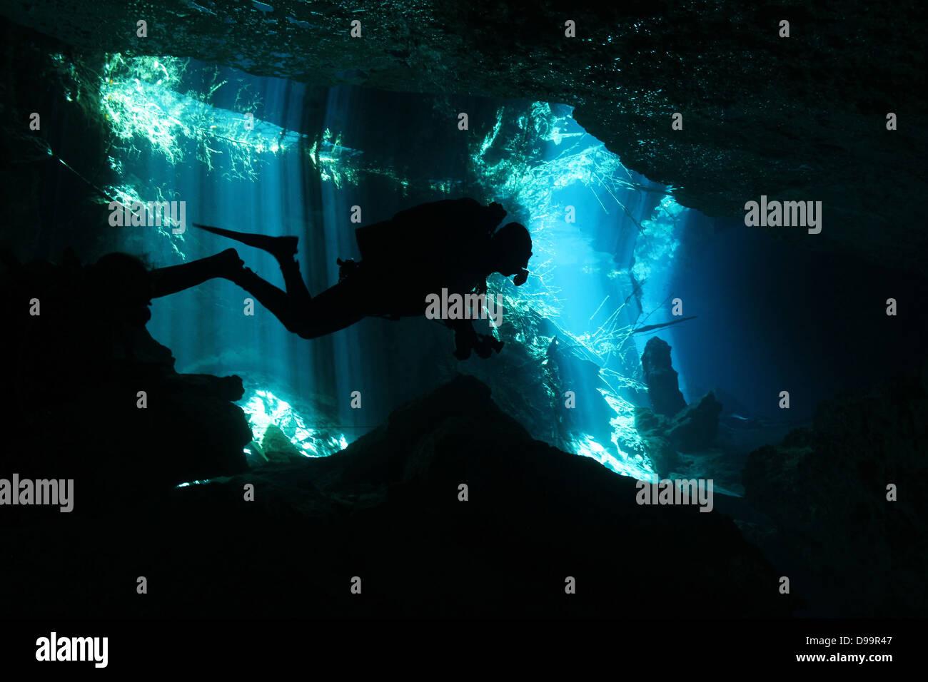 Diver in Chac-Mool Cenote, Playa del Carmen, Mexico - Stock Image