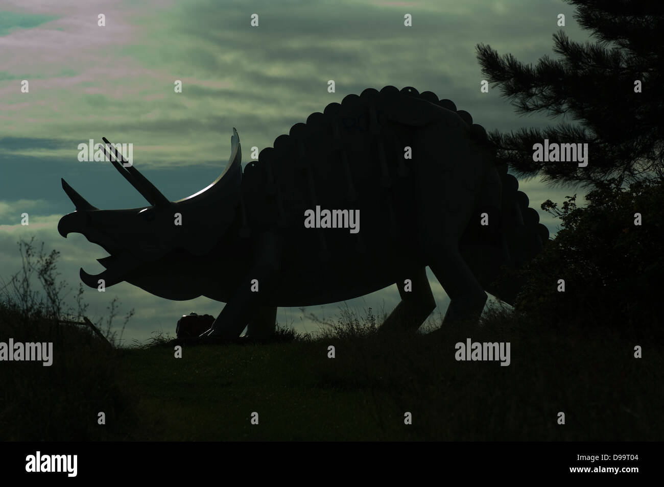 metal dinosaurs in middlesbrough in silhouette - Stock Image