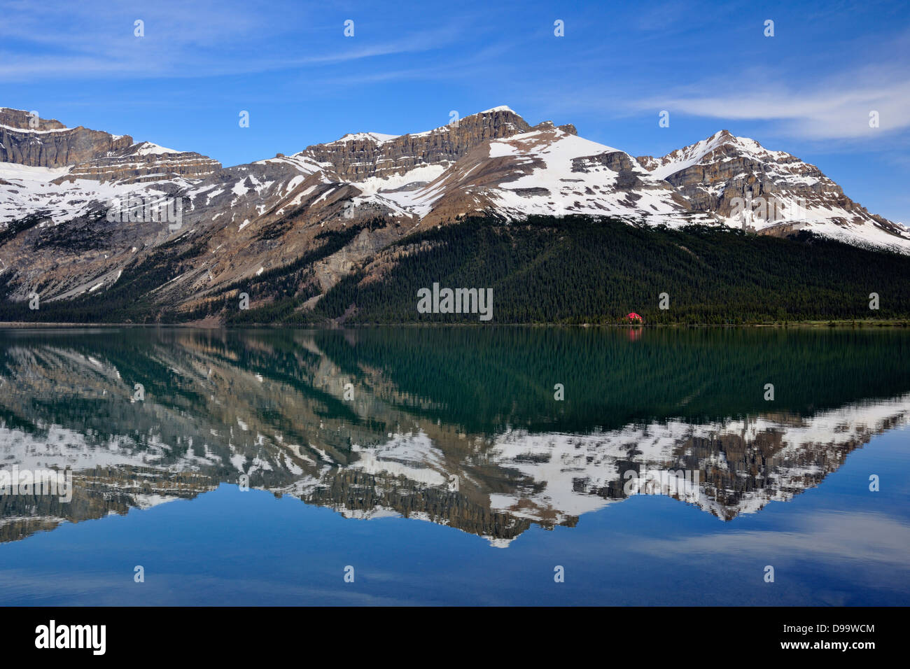 Reflections in Bow Lake with Num-ti-jah Lodge Banff National Park Alberta Canada - Stock Image